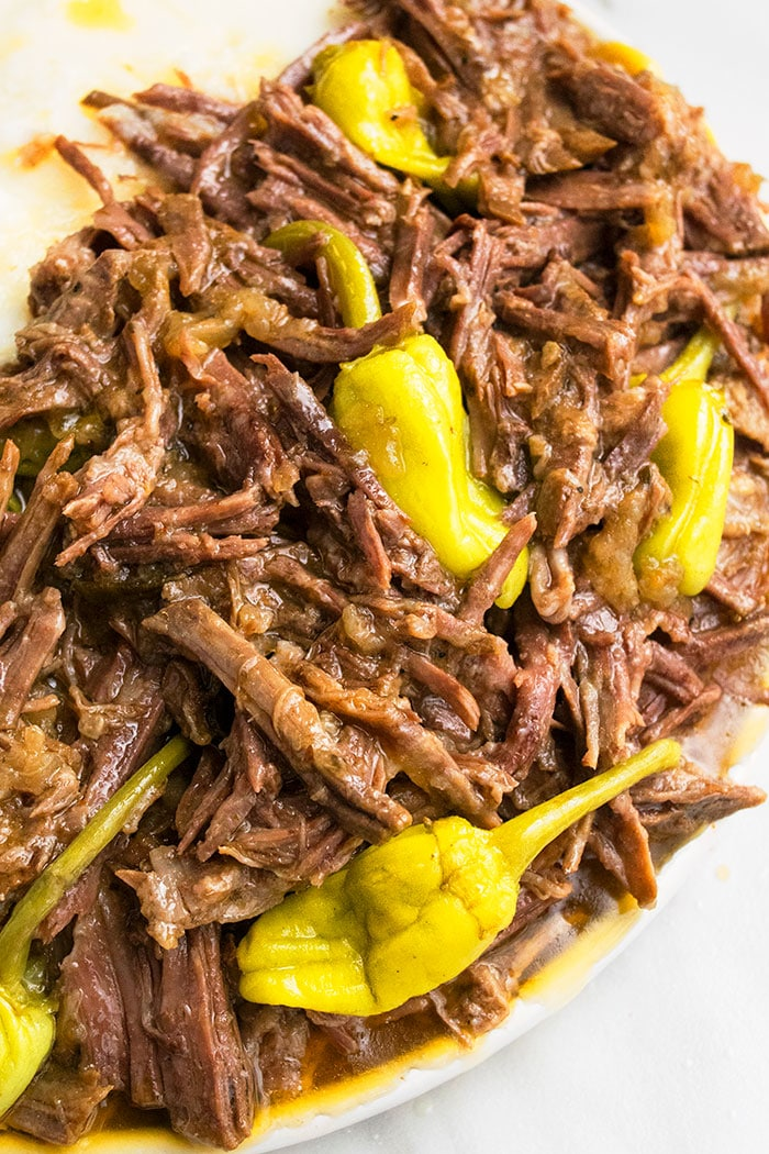 Easy Mississippi Pot Roast with Pepperoncini Peppers on White Plate