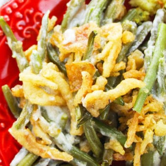 Easy Crockpot Thanksgiving Green Bean Casserole Served in Red Dish