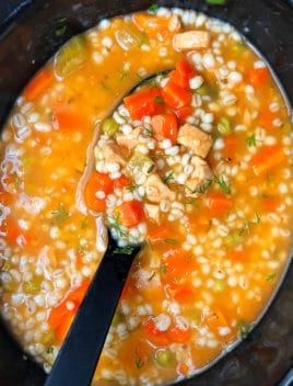 Easy Homemade Chicken Barley Soup in Black Slow Cooker