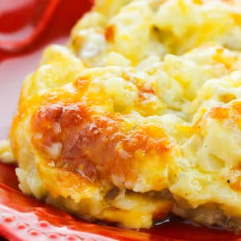 Homemade Crockpot Cheesy Shredded Hashbrown Casserole in Red Plate