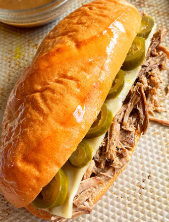 Easy Homemade French Dip Sandwich with Bowl of Au Jus on Silver Tray