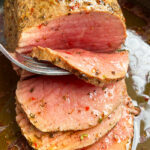 Easy Homemade Slow Cooker Roast Beef With Fork Separating Slice