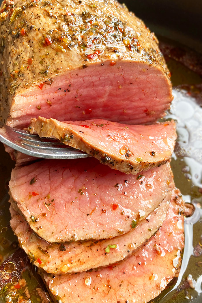 Easy Homemade Beef Roast With Fork Separating Slice