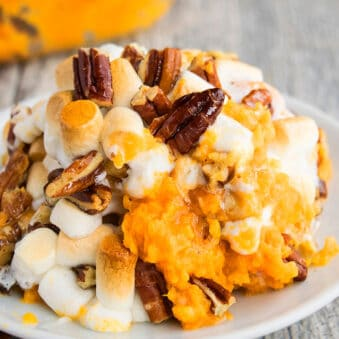 Easy Homemade Sweet Potato Casserole Prepared in Crockpot and Served in White Plate