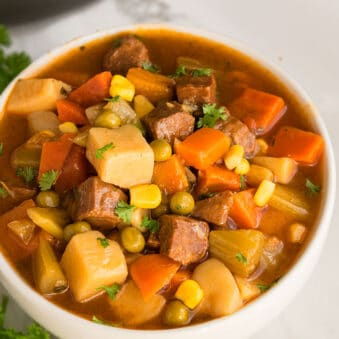 Slow Cooker Beef Stew Served in White Bowl on Marble Background