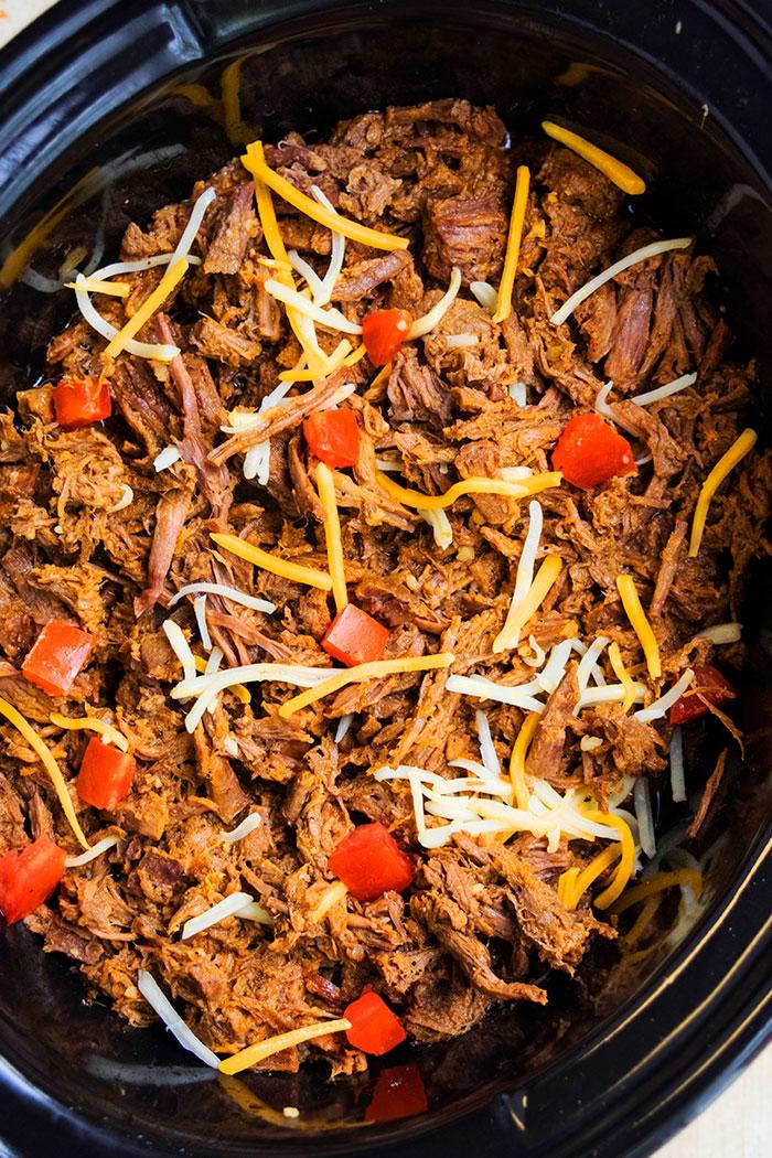 Easy Homemade Barbacoa Beef in Black Slow Cooker- Overhead Shot