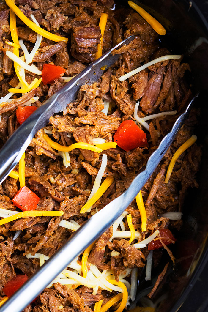 Mexican Barbacoa Chipotle in Black Crockpot with Tongs