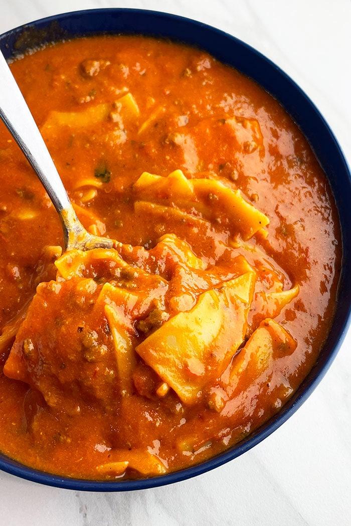 Crockpot Lasagna Soup Served in Blue Bowl on White Background
