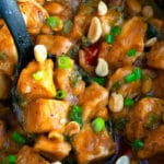 Spoonful of Easy Thai Peanut Chicken in Black Slow Cooker