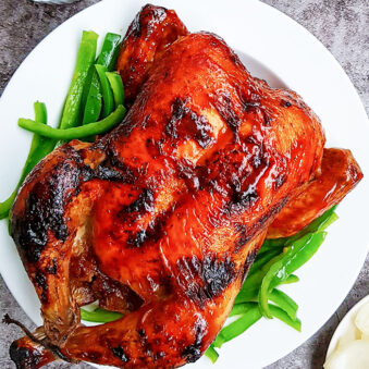 Slow Cooker Tandoori Chicken on White Plate with Gray Background