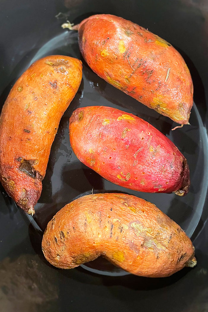 Four Sweet Potatoes in Black Slow Cooker