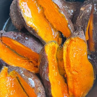Easy Homemade Baked Sweet Potatoes Sliced in Half in Black Crockpot