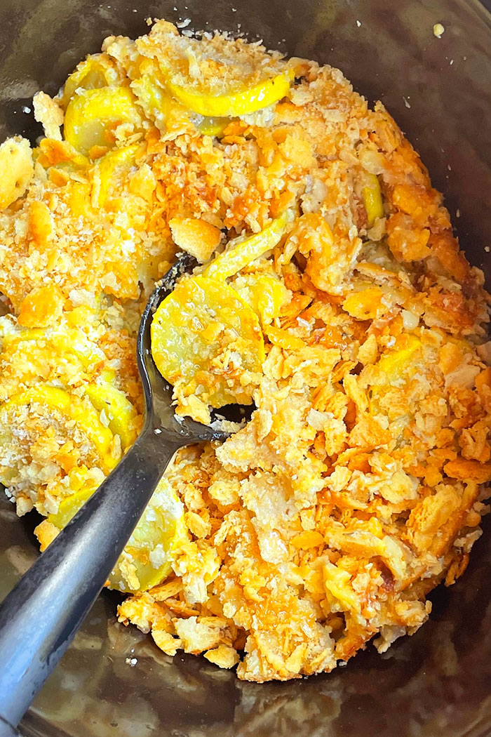 Yellow Squash Casserole in Black Slow Cooker- Overhead Shot