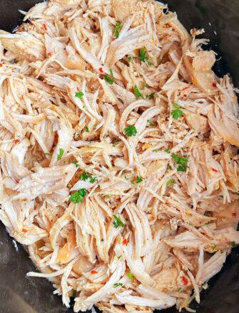 Easy Shredded Chicken or Pulled Chicken in Black Slow Cooker- Overhead Shot