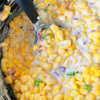 Slow Cooker Corn Dip in Black Crockpot- Overhead Shot