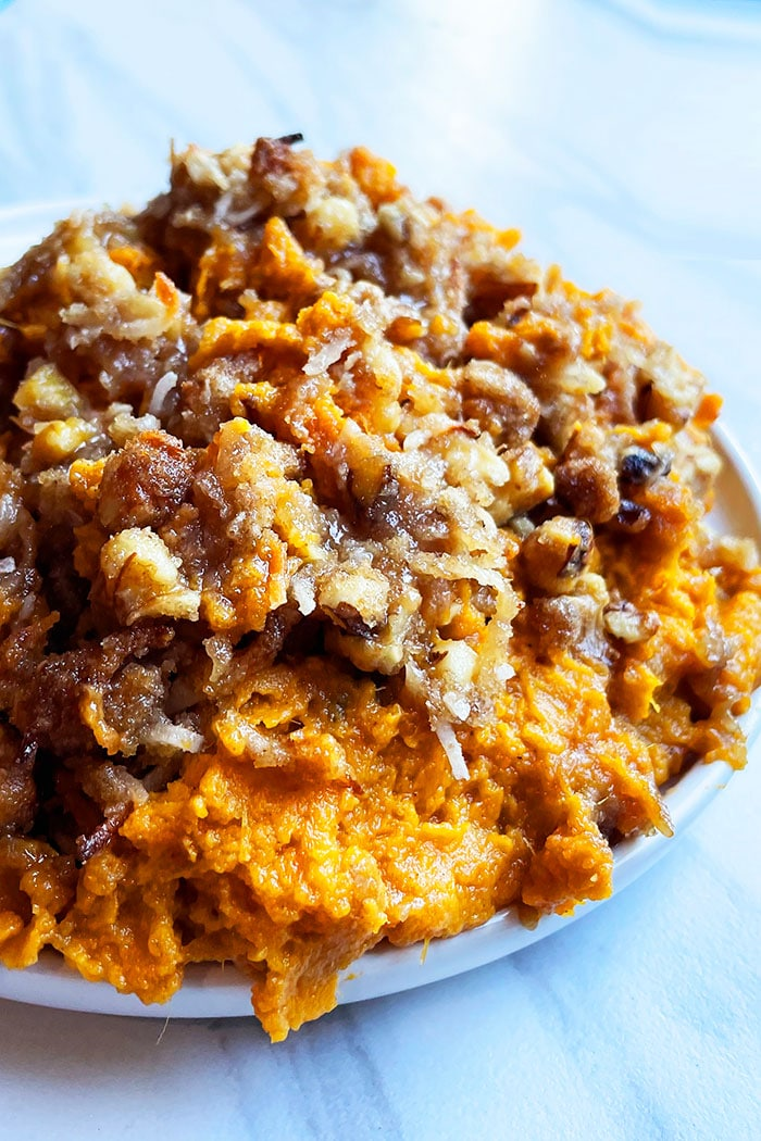Easy Sweet Potato Souffle With Pecan Brown Sugar Topping in White Plate