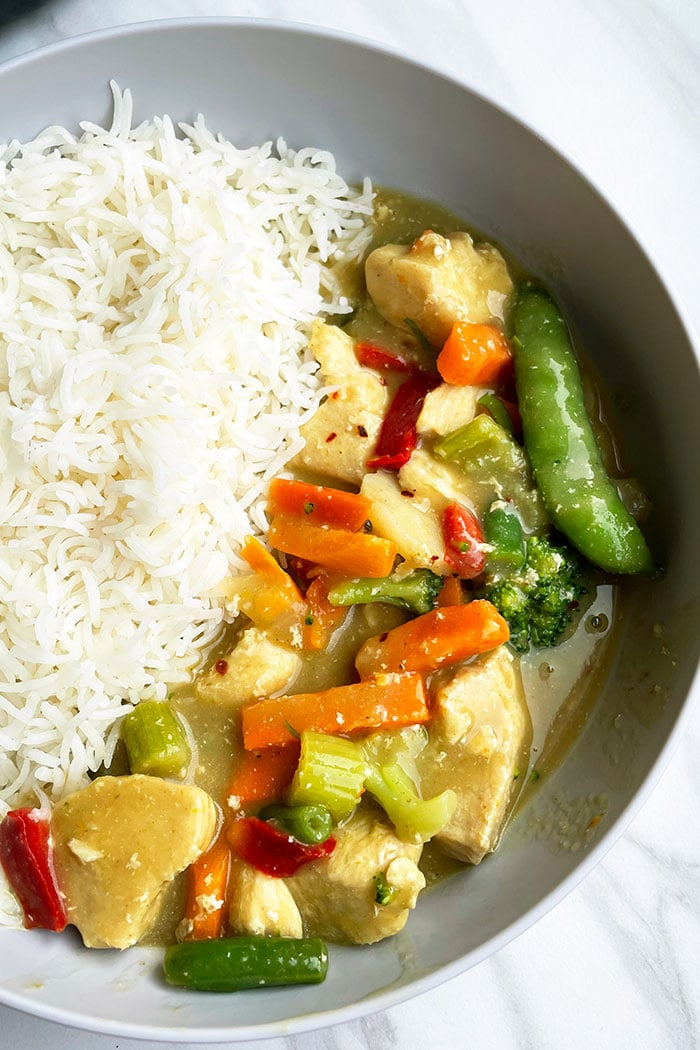 Gray Bowl Filled With Steamed Rice and Thai Green Curry