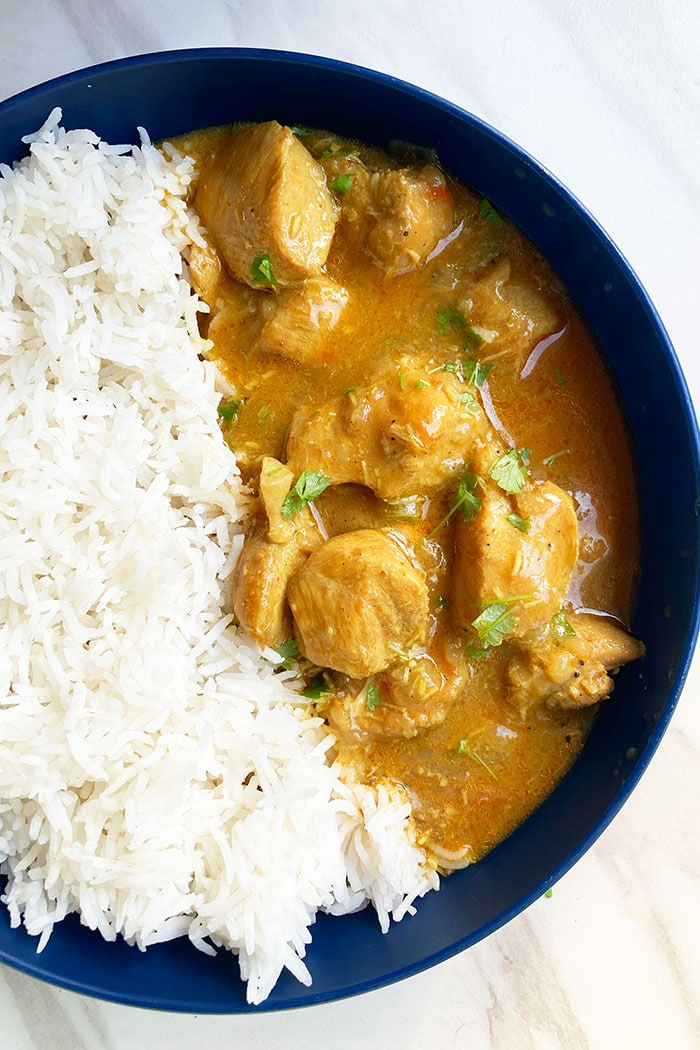 Blue Bowl With Rice and Curry on White Marble Background