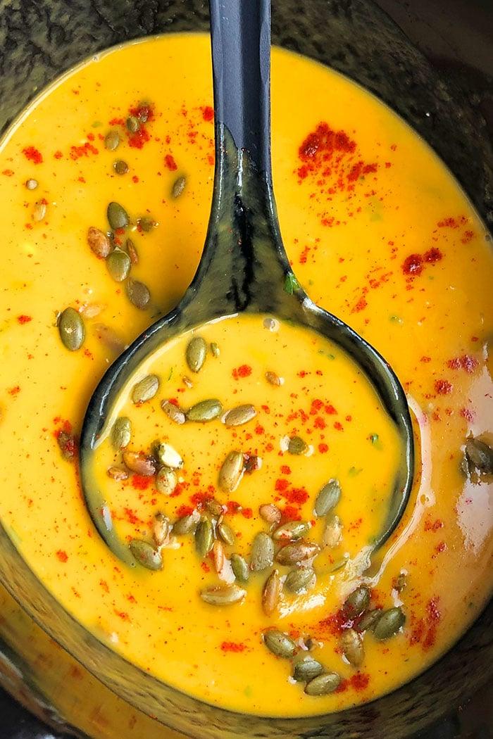 Easy Pumpkin Soup Served in Black Slow Cooker